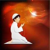 stock photo of namaz  - Young Muslim boy in traditional dress praying  - JPG