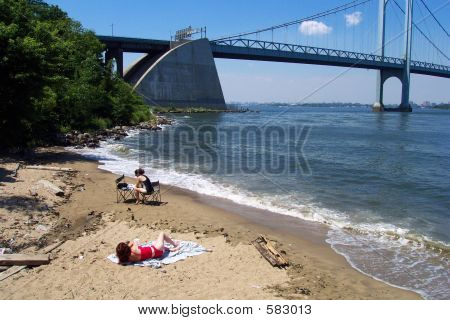 Sun Bathing By The Bridge