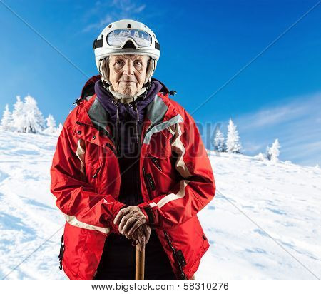 Senior woman wearing ski jacket on snowy slope