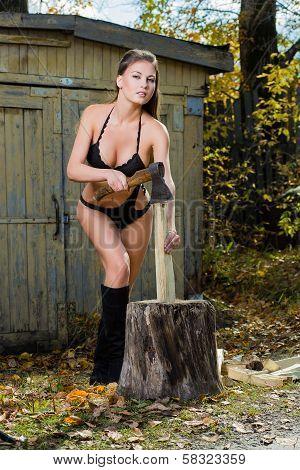 naked woman chopping wood. lumberjack