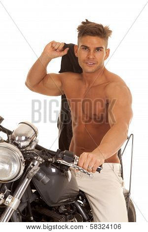 Man No Shirt Jacket Over Shoulder On Motorcycle