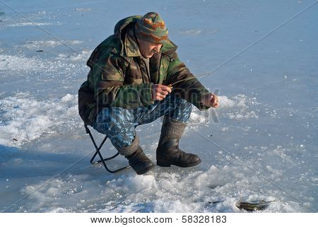 Man On Winter Fishing