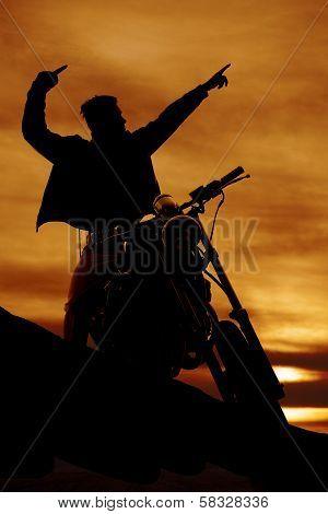 Silhouette Of A Man On A Motorcycle Pointing