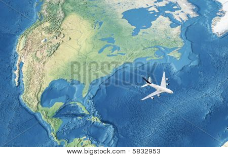 A white Civil Airplane Over The Atlantic Ocean Flying To Europe