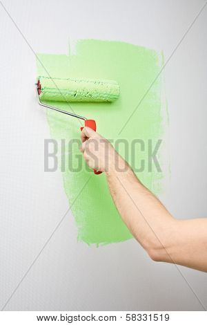 Painting The Wall With Roller