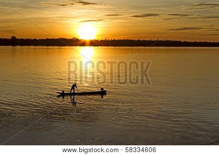 Fishing Man And Small Boat
