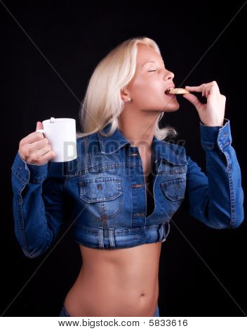 Portrait Of Blonde Biting A Cookie