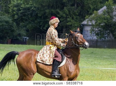 History Fan Dressed As 17Th Century Polish Cavalryman With A Sabre In His Hand