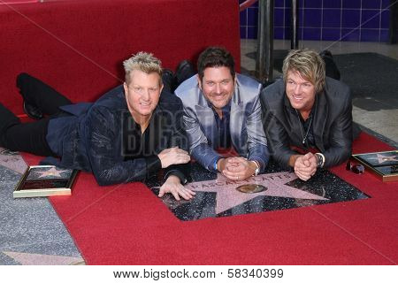 Jay Demarcus and Joe Don Rooney and Gary LeVox of the Rascal Flatts on the on the Hollywood Walk of Fame, Hollywood, CA 09-17-12