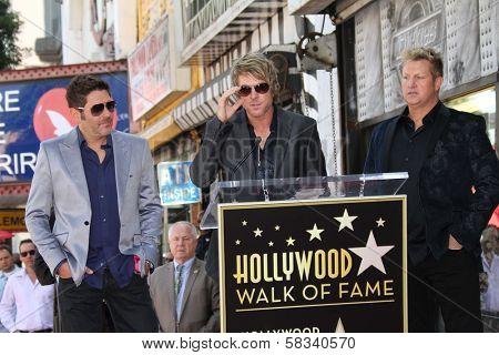 Jay Demarcus, Joe Don Rooney and Gary LeVox, at the Rascal Flatts Star on the Hollywood Walk of Fame, Hollywood, CA 09-17-12