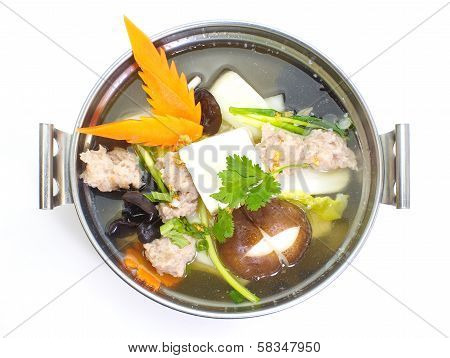 Mild soup with vegetables, pork, mushrooms and bean curd.