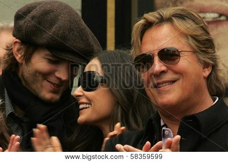 Ashton Kutcher with Demi Moore and Don Johnson at the Ceremony honoring Bruce Willis with the 2,321st star on the Hollywood Walk of Fame. Hollywood Boulevard, Hollywood, CA. 10-16-06
