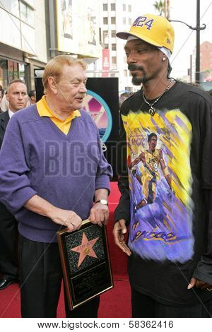 Jerry Buss and Snoop Dogg at the Ceremony Honoring Los Angeles Lakers Owner Jerry Buss with the 2,323rd star on the Hollywood Walk of Fame. Hollywood Boulevard, Hollywood, CA. 10-30-06