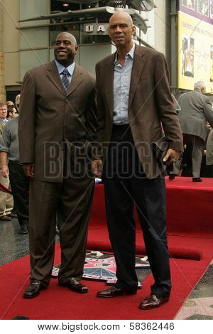 Magic Johnson and Kareem Abdul-Jabbar at the Ceremony Honoring Los Angeles Lakers Owner Jerry Buss with the 2,323rd star on the Hollywood Walk of Fame. Hollywood Boulevard, Hollywood, CA. 10-30-06