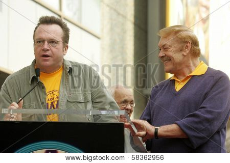 Tom Arnold and Jerry Buss at the Ceremony Honoring Los Angeles Lakers Owner Jerry Buss with the 2,323rd star on the Hollywood Walk of Fame. Hollywood Boulevard, Hollywood, CA. 10-30-06