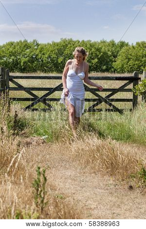 Young Woman Strolling In The Countryside In Summer