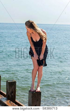 Young Woman Enjoying Herself At The Seaside