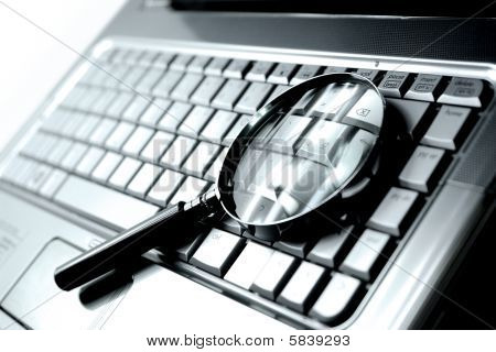 Laptop Computer + Magnifying Glass