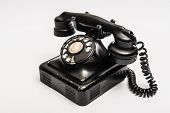 foto of rotary dial telephone  - Vintage telephone with rotary dial on a white background - JPG