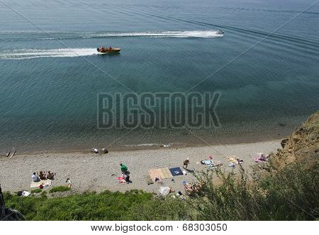 Siberia, RU - July,13 2014: Boats on the Lake Baikal in Listvyanka village in July,13 2014, Siberia,