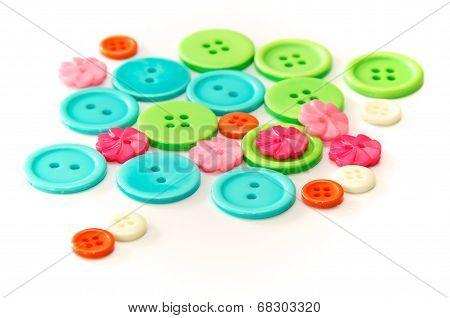 Assorted Colorful Buttons Over White