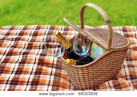 Picnic Blanket And Basket In The Grass
