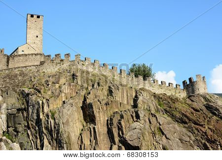 BELLINZONA, SWITZERLAND - July 4, 2014: The Torre Bianca (White tower) and ramparts of the Castelgrande in Bellinzona, Switzerland. A UNESCO World Heritage Site, seen from below.