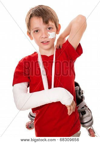 Boy With A Broken Arm Holding Roller Skates