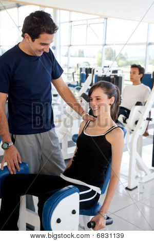 Gym Woman With Trainer