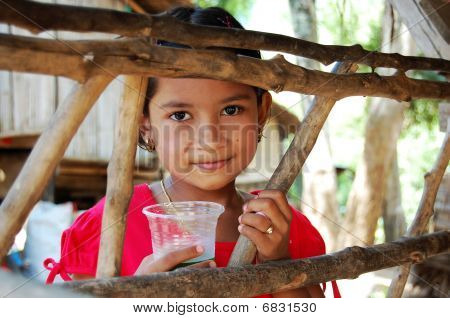 Thailand Girl behind the wooden fence