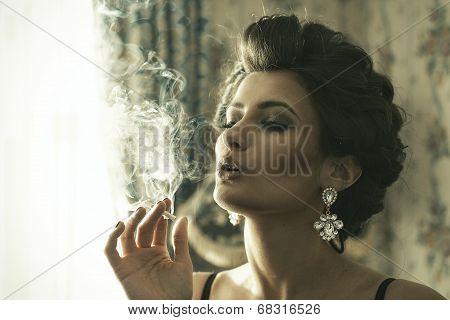 Elegant Brunette Woman Smoking A Cigarette
