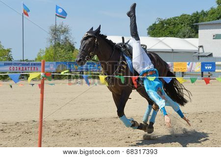 LYTKARINO, MOSCOW REGION, RUSSIA - JULY 12, 2014: Alexandra Kalinina performs stunts during Russian championship in trick riding. Lytkarino housed the Russian Federation of trick riding