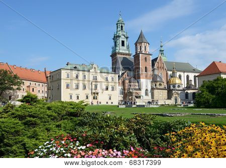 KRAKOW, POLAND - SEPTEMBER 15, 2013: Tourists near the Wawel cathedral. Originally built in the XIV century, the cathedral is a most important burial place of Polish kings and national heroes