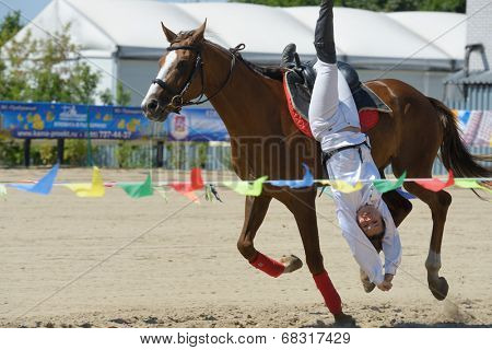 LYTKARINO, MOSCOW REGION, RUSSIA - JULY 12, 2014: Natalya Petrusinskaya performs stunt during Russian championship in trick riding. Lytkarino housed the Russian Federation of trick riding