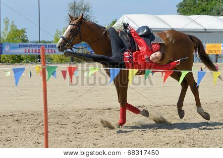 LYTKARINO, MOSCOW REGION, RUSSIA - JULY 12, 2014: Anastasia Plavunova performs stunts during Russian championship in trick riding. Lytkarino housed the Russian Federation of trick riding