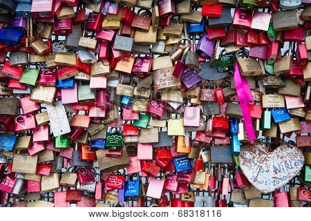 COLOGNE, GERMANY - MAY 29, 2014, Thousands of love locks which sweethearts lock to the Hohenzollern Bridge to symbolize their love on May 29 in Koln, Germany