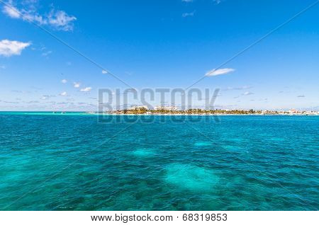 tropical sea and Isla Mujeres coast view from sea in Mexico