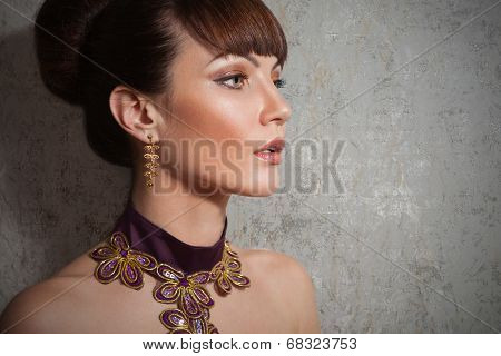 Beautiful woman with in evening dress with make up