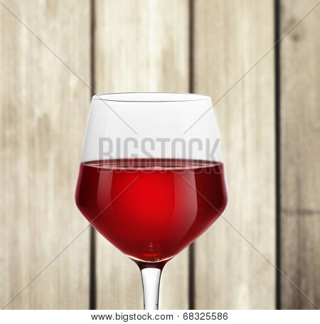 Red Wine in glass on wood background