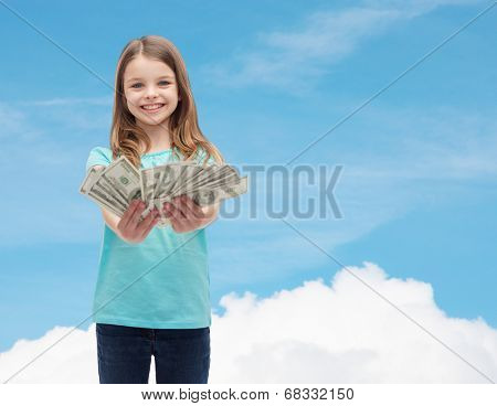 money, finances and people concept - smiling little girl giving dollar cash money