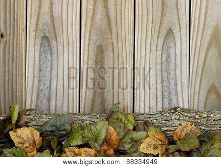Autumn leaves and log border rustic wood background