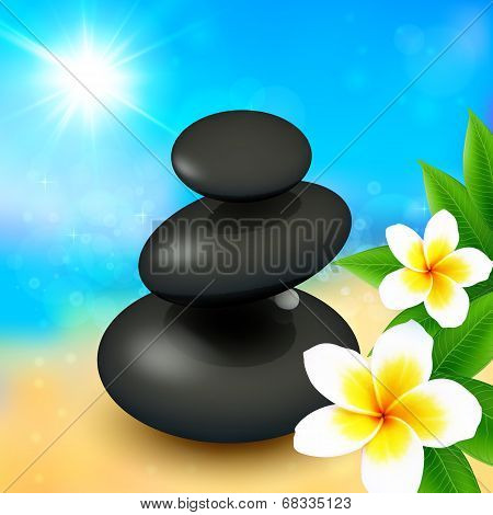 Black spa rocks with flowers on summer background