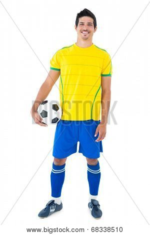 Football player in yellow with ball on white background