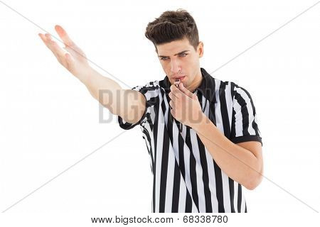 Stern referee blowing his whistle on white background
