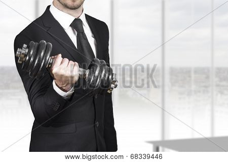 Businessman Weightlifting In Office