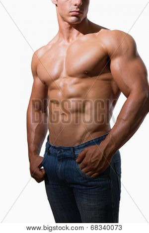 Mid section of a shirtless muscular man over white background