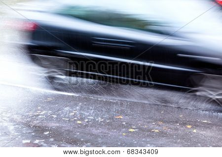 Speedy Car On Wet Road