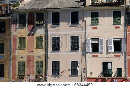 PORTOFINO, ITALY - MAY 04, 2014: Colorful pastel houses. Portofino is an Italian fishing village famous for its picturesque harbor and historical association with celebrity visitors,