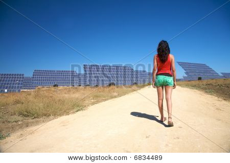 Woman And Solar Panels In Cadiz