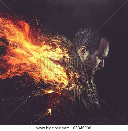 fallen angel, jacket man with golden feathers on the wings and fire